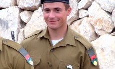 IDF Sgt. Sergei Meyerson smiles as he stands at attention at a graduation ceremony for tank commanders training held at the armys tank corps museum at Latrun, near Jerusalem