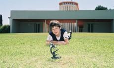 boy on grass in fron of weizman institute