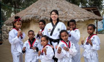 הכירו את ציונה ריו, שהגיעה לישראל מדרום קוריאה כדי ללמד עולים מאתיופיה טאיקוונדו