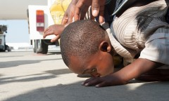 Home! A young Ethiopian immigrant kisses the ground after landing in Israel