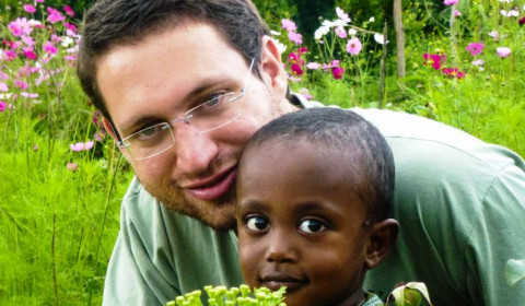 Jewish Agency for Israel TEN Global Tikkun Olam representative Shai Mark with Ethiopian child in Gondar Province