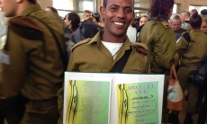 IDF Sgt. Ezra Adana proudly hold his Outstanding Soldier certificate, at the conclusion of an award ceremony held in Maalot-Tarshsha in northern Israel